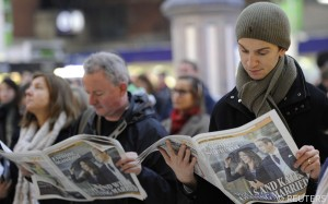 Commuters-Reading-Evening-Standard-watermarked
